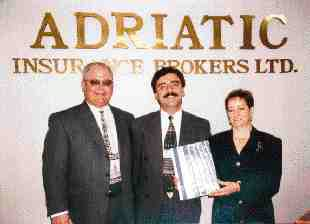 Sovereign General Insurance Company recently celebrated entering the Ontario commercial automobile field. Pictured are Ralph Cole, Sovereign's business development manager, Nick Maniatis, producer of Sovereign's first policy - with Adriatic Insurance Brokers, and Rita Nicolette, Sovereign's senior commercial automobile underwriter.