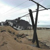 A beach house in Kitty Hawk, NC, is knocked off its moorings by Hurricane Isabel