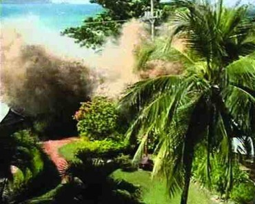 Amateur video shows the December 26, 2004 tsunami's waves crashing into Phuket, Thailand.