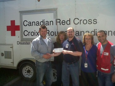 Shaun Talbot, a project manager with Paul Davis Systems of Thunder Bay, presented the donation cheque to Red Cross this past week.