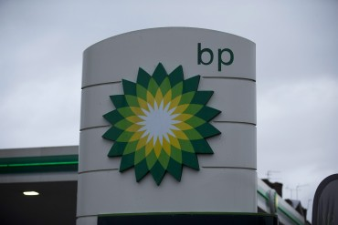 The logo of the BP is seen outside its petrol station in East Molesey, southwest London, Tuesday, Feb. 2, 2016. The British oil company said fourth-quarter earnings plunged 91 percent because of sharp declines in oil prices. BP reported Tuesday that underlying replacement cost profit fell to $196 million from $2.2 billion in the same quarter a year earlier. (AP Photo/Matt Dunham)