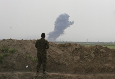 Smoke rises from positions in the Islamic State group held town of Besher, during a military operation to regain control of the small town, outside the oil-rich city of Kirkuk, 180 miles (290 kilometers) north of Baghdad, Iraq, Sunday, April 10, 2016. (AP Photo/Anmar Khalil)
