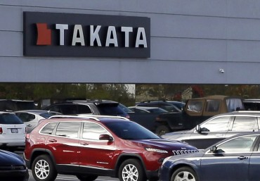 FILE - This Oct. 22, 2014, file photo, shows the North American headquarters of automotive parts supplier Takata in Auburn Hills, Mich.  The nation's highway safety watchdog says U.S. cars and trucks have about 85 million Takata air bag inflators in them that haven't been recalled. Takata's inflators can explode with too much force and spew shrapnel into drivers and passengers. (AP Photo/Carlos Osorio, File)