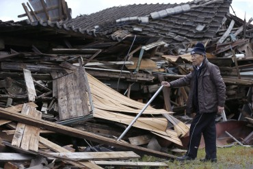 Damaged houses in Aso, Kumamoto prefecture, Japan, April 17, 2016. Two nights of earthquakes flattened houses and triggered major landslides in southern Japan. Photo by Shizuo Kambayashi, The Associated Press