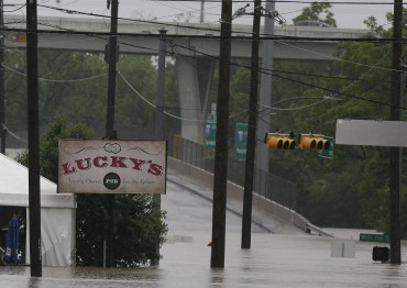 Lucky's Pub is not so lucky after flood water engulfed it Monday, April 18, 2016, in Houston. More than a foot of rain fell Monday in parts of Houston, submerging scores of subdivisions and several major interstate highways, forcing the closure of schools and knocking out power to thousands of residents who were urged to shelter in place. (AP Photo/Pat Sullivan)