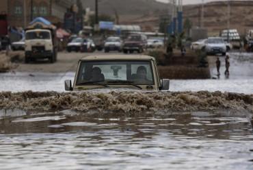 A motorist drives in flood waters after a heavy rain in Sanaa, Yemen, Wednesday, April 13, 2016. Hani Mohammed, The Associated Press