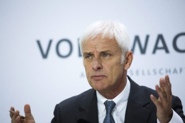 Volkswagen CEO Matthias Mueller attends the company's annual press conference in Wolfsburg, Germany, Thursday, April 28, 2016. Mueller sketched out a wide-ranging transformation of the company that will see it focus more on electric vehicles and services like car-sharing as it seeks to get past its scandal over cheating on diesel emissions tests. (AP Photo/Markus Schreiber)