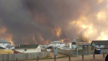 A wall of fire rages outside of Fort McMurray, Alta. Tuesday May 3, 2016 as a wildfire threatened the city. Raging forest fires whipped up by shifting winds sliced through the middle of the remote oilsands hub city of Fort McMurray, sending tens of thousands fleeing in both directions and prompting the evacuation of the entire city. THE CANADIAN PRESS/ Mary Anne Sexsmith-Segato