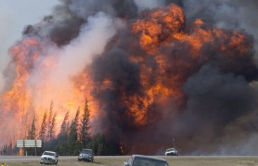 A giant fireball is seen as a wild fire rips through the forest 16 km south of Fort McMurray, Alberta on highway 63 Saturday, May 7, 2016. THE CANADIAN PRESS/Jonathan Hayward
