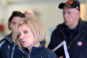 Alberta Premier Rachel Notley, left, speaks at the Fort McMurray fire department as fire chief Darby Allen looks on in Fort McMurray, Alta., on Monday, May 9, 2016. THE CANADIAN PRESS/Jonathan Hayward