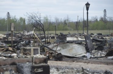 The burned-out neighbourhood of Beacon Hill is seen in Fort McMurray, Alberta, Monday, May 9, 2016. Cleaning up after the Fort McMurray wildfire will test the city's ability to handle everything from asbestos to rotting food and leave a lasting legacy of higher costs and dangerous residue.THE CANADIAN PRESS/Jonathan Hayward