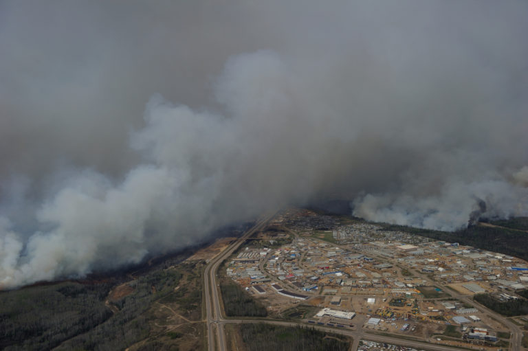 Aerial view of the wild fires in the Fort McMurray area on May 4, 2016. Photo by MCpl VanPutten, Canadian Forces