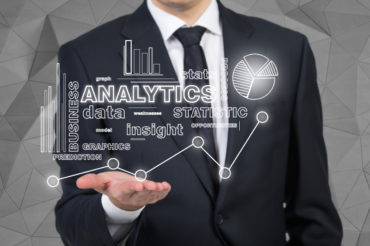 businessman holding analytics