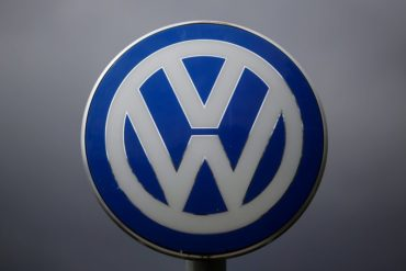 A Volkswagen emblem VW at a factory entrance is pictured during the company's annual press conference in Wolfsburg, Germany, Thursday, April 28, 2016. (AP Photo/Markus Schreiber)