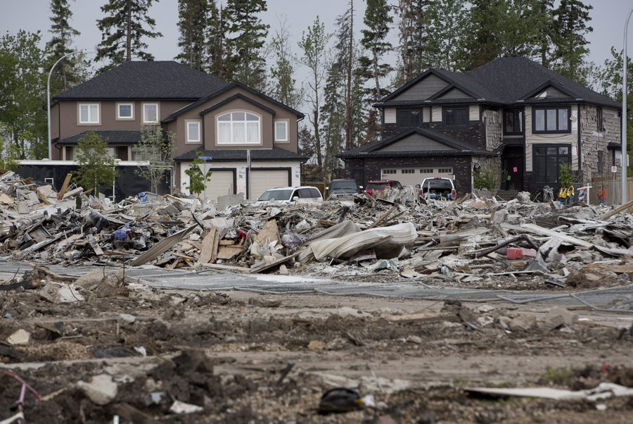 The devastated neighbourhood of Timberlea in Fort McMurray Alta. is shown on Wednesday June 1, 2016. Residents returned after being evacuated during wildfires. THE CANADIAN PRESS/Jason Franson