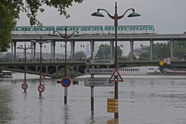 Road signs emerge on the banks of the Seine river next to the Bir Hakeim bridge during floods in Paris, Saturday, June 4, 2016. The level of the Seine started to drop after peaking earlier in the morning. Both the Louvre and Orsay museums were closed as officials said the Seine had been at its highest level in nearly 35 years. (AP Photo/Francois Mori)