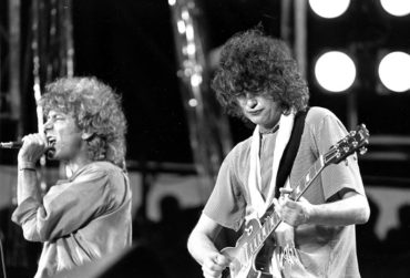 "FILE - In this July 13, 1985 file photo, singer Robert Plant, left, and guitarist Jimmy Page of the British rock band Led Zeppelin perform at the Live Aid concert at Philadelphia's J.F.K. Stadium. Generations of aspiring guitarists have tried to copy the riff from Led Zeppelin's '""Stairway to Heaven."" Starting Tuesday, June 14, 2016, a Los Angeles court will try to decide whether the members of Led Zeppelin themselves ripped off that riff. Page and Plant are named as defendants in the lawsuit brought by the trustee of late guitarist Randy Wolfe from the band Spirit. (AP Photo/Rusty Kennedy, File)"