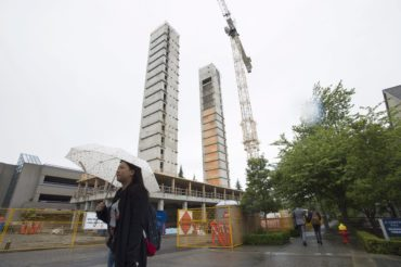 A new building is being built at the University of British Columbia campus in Vancouver, B.C., Monday, June, 13, 2016. The 18-storey Brock Commons is intended to show developers and the public that wood can be equally as effective as steel or concrete, better for the environment and support the country's forestry industry. THE CANADIAN PRESS/Jonathan Hayward