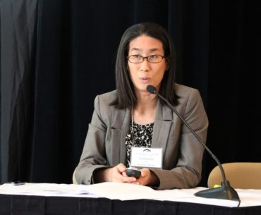 Cynthia Aoki, an associate lawyer with McLennan Ross LLP, panelist at The ARC Group Annual Seminar
