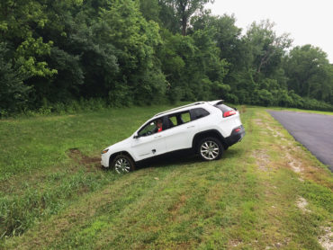 Miller attempts to rescue the Jeep after its brakes were remotely disabled, sending it into a ditch. Andy Greenberg/WIRED
