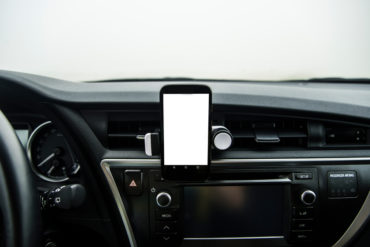 Mobile phone on car with copy space