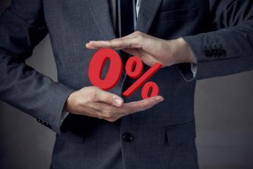 Business man Presenting Zero Percent, indicating zero interest a