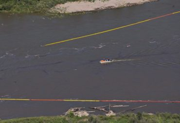 Crews work to clean up an oil spill on the North Saskatchewan river near Maidstone, Sask on Friday July 22, 2016. Husky Energy has said between 200,000 and 250,000 litres of crude oil and other material leaked into the river on Thursday from its pipeline. THE CANADIAN PRESS/Jason Franson