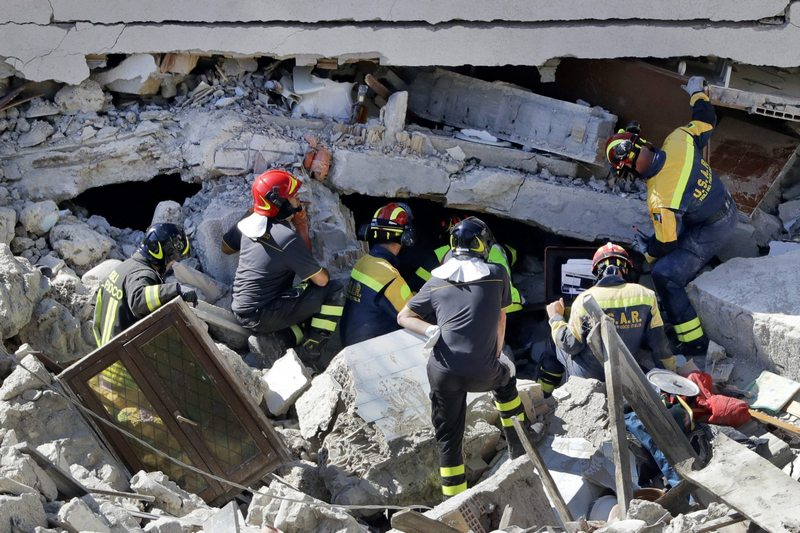 Rescuers search for victims beneath destroyed houses following Wednesday's earthquake in Pescara Del Tronto, Italy, Thursday, Aug. 25, 2016. Rescue crews raced against time Thursday looking for survivors from the earthquake that leveled three towns in central Italy, but the death toll rose to 247 and Italy once again anguished over trying to secure its medieval communities built on seismic lands. (AP Photo/Gregorio Borgia)