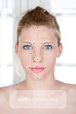 Face detection software recognizing a face of young woman