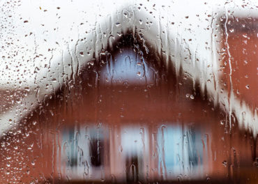 View from the window of a private house in rainy weather