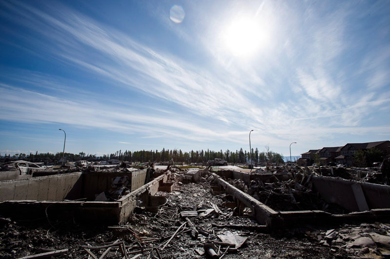 Burned-out homes and vehicles are seen in the Timberlea neighbourhood as residents re-enter fire-ravaged Fort McMurray, Alta., on Thursday, June 2, 2016. THE CANADIAN PRESS/Codie McLachlan