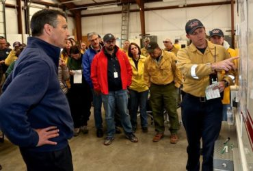 Truckee Meadows Battalion Chief Alex Kukulus, right, gives Nevada Gov. Brian Sandoval an update on the Little Valley fire in Washoe Valley Friday, Oct. 14, 2016. Sandoval toured the area shortly after the briefing. (Brad Coman/Nevada Appeal via AP)