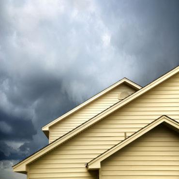 siding house under storm