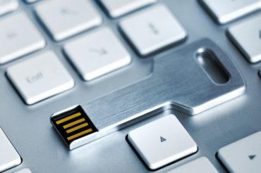 USB flash storage metal key on Keyboard