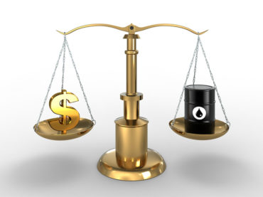 Dollar sign and Oil Barrel in balance (Clipping path included)