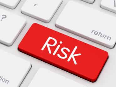 Risk written on keyboard key