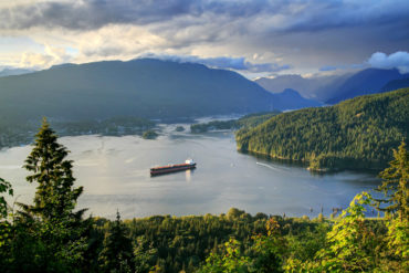Burrard Inlet at sunset, aerial view from a mountain at sunset time
