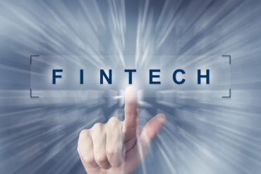 hand clicking on fintech or Financial technology button