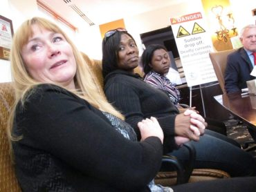 Sandra Smith, left, Tasha Hart, center, and Domonique McNeil, right, speak at a news conference in Egg Harbor Township N.J. on Tuesday Oct. 25, 2016 about the drowning deaths of relatives at a beach in North Wildwood N.J. Lawyers for Smith's family are trying to get a judge to order that section of beach permanently closed to the public because the sand is prone to giving way under the feet of beachgoers, plunging them into water over their heads. (AP Photo/Wayne Parry)