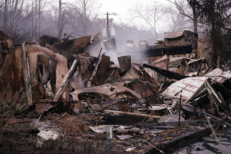 The remains of a business Wednesday, Nov. 30, 2016, after a wildfire hit Gatlinburg, Tennessee. Photo by Mark Humphrey, The Associated Press