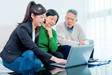 Asian senior couple meeting with financial planner