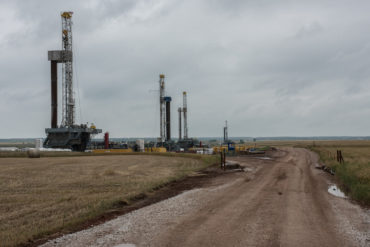 Fracking oil rig drills in Oklahoma field.