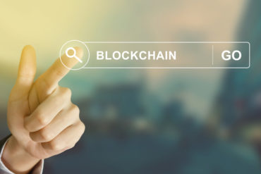 business hand clicking blockchain button on search toolbar