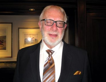 Philip Cook, CEO of Omega Insurance Holdings Inc.