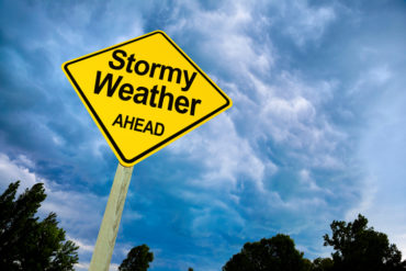 Stormy Weather Ahead Road Sign