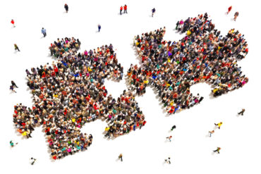 Large group of people in the shape of two puzzle pieces on a white background