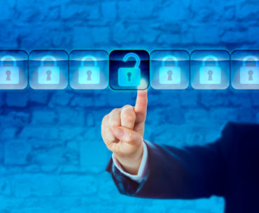Hand of a business person is unlocking an information packet