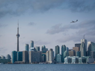 Toronto's CN Tower with airplane landing