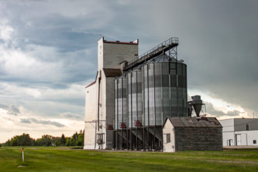 Old Wooden Grain Elevator Against Dramatic Sky