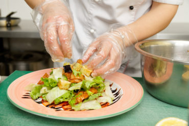Chef is cooking appetizer at commercial kitchen
